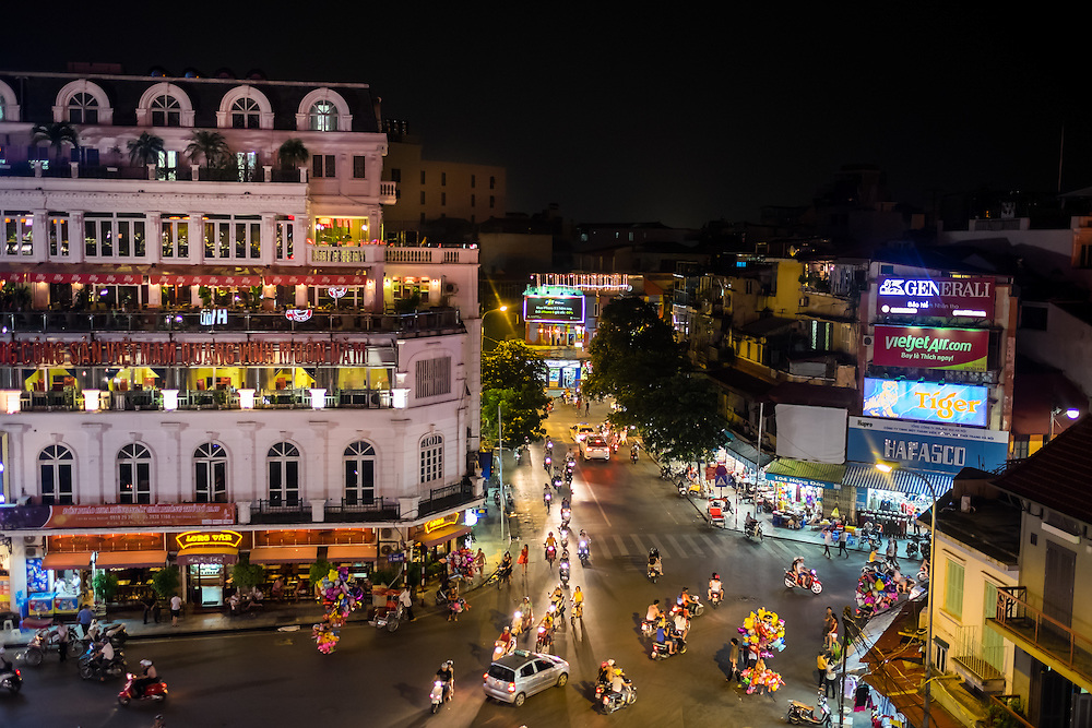 HANOI, VIETNAM - CIRCA SEPTEMBER 2014:  Busy corner street in the Hanoi Old Quarter at night in Vietnam.