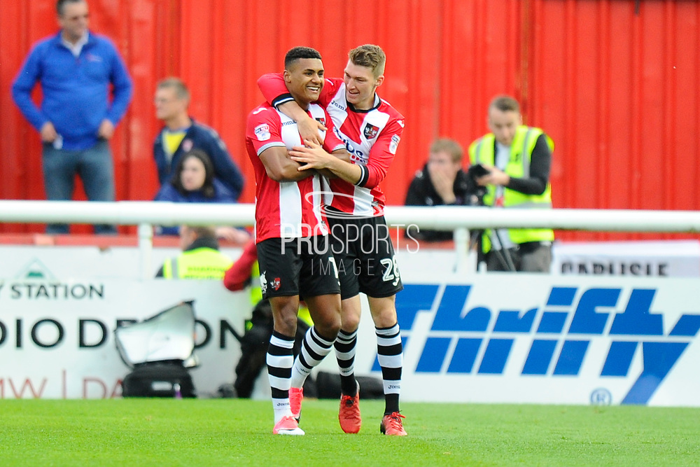 Ollie Watkins (14) of Exeter City celebrates scores a goal with Jack Stacey (28) of Exeter City to give a 1-0 lead to the home team during the EFL Sky Bet League 2 play off second leg match between Exeter City and Carlisle United at St James' Park, Exeter, England on 18 May 2017. Photo by Graham Hunt.