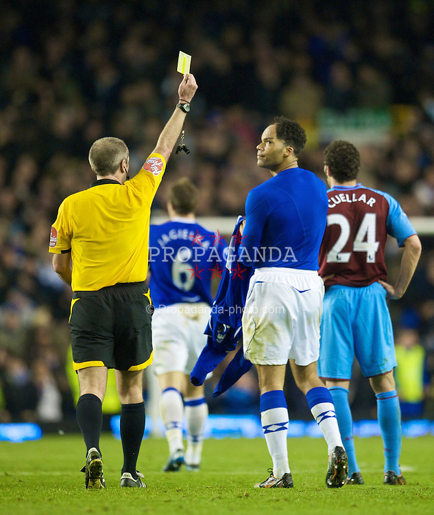 LIVERPOOL, ENGLAND - Sunday, December 7, 2008: Everton's Joleon Lescott is shown the yellow card by the referee after celebrating his side's second equalising goal against Aston Villa during the Premiership match at Goodison Park. (Photo by David Rawcliffe/Propaganda)