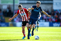 Edward Upson of Bristol Rovers takes on Harry Toffolo of Lincoln City - Mandatory by-line: Robbie Stephenson/JMP - 14/09/2019 - FOOTBALL - Sincil Bank Stadium - Lincoln, England - Lincoln City v Bristol Rovers - Sky Bet League One