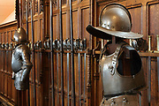Suits of armour and weaponry on display in James IV's Great Hall, 1503-13, the chief assembly hall in the castle, on Crown Square, in Edinburgh Castle on Castle Rock, Edinburgh, Scotland. The Great Hall was used as a military barracks in the 17th and 18th centuries and as a military hospital in the 19th century, then restored by Hippolyte Blanc, 1844-1917, to medieval style. The first royal castle built here was under David I in the 12th century, and the site has been built on, attacked and defended ever since. The castle now houses military museums and the National War Museum of Scotland and is run by Historic Scotland. Picture by Manuel Cohen