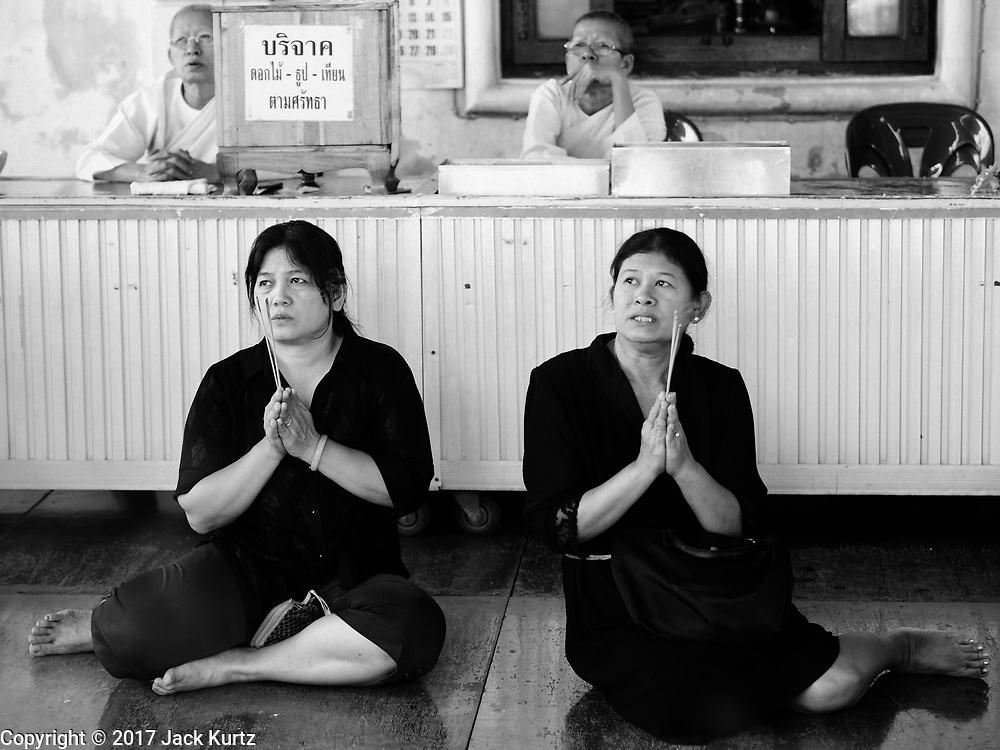 04 ARIL 2017 - BANGKOK, THAILAND: People pray and make merit at Wat Rakhang. Wat Rakhang Khositaram, formerly known as Wat Bang Wa Yai, is an Ayutthaya period temple.  During the Thon Buri period, the temple was reconstructed and upgraded as a royal temple by King Taksin the Great who ordered the construction of a palace in the area.       PHOTO BY JACK KURTZ