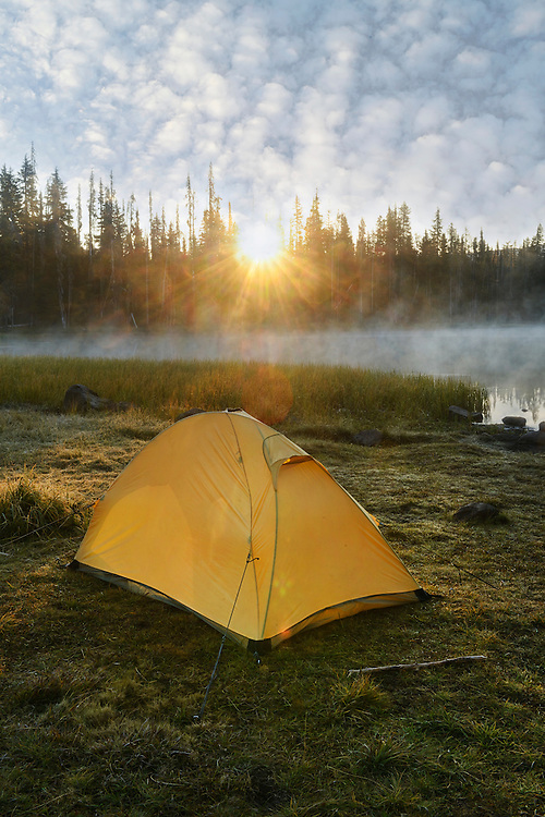 Yellow tent at sunrise, Scott Lake, Three Sisters, Cascade Mountains, Central Oregon, Lane County,Oregon, USA