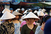 Cholon (Chinatown). Binh Tay Market. Women waering traditional cone hats.