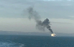 Isle of Wight Thursday 19th January 2017 <br /> Wightlink ferry on fire off Isle of Wight<br /> Credit Andy Hurst/UKNIP<br /> <br /> <br /> <br /> <br /> A fire has broken out on a Wightlink ferry as it crossed the Solent.  <br /> <br /> <br /> <br /> The Lee-on-the-Solent coastguard said the fire was on the bridge wing and not an area where passengers are.<br /> <br /> <br /> <br /> <br /> <br /> It is not yet know if anyone onboard has been injured in the blaze.    <br /> <br /> <br /> <br /> The ship was heading to Fishbourne when the emergency call was made  to the fire service just after 9.30am. <br /> <br /> <br /> <br /> An Isle of Wight Fire and Rescue Service spokeswoman said two fire engines from Ryde were called to the port, and the Coastguard and Marine Police were standing by.  <br /> <br /> <br /> <br /> UPDATE from Solent Coastguard : <br /> <br />  <br /> <br /> All passengers safely evacuated after ferry fire this morning<br /> <br /> At about 9.30 today the St Faith Wight Link car ferry contacted the UK Coastguard reporting a fire on their bridge wing port side.  When the call was made, the vessel was on route from Portsmouth to Fishbourne, Isle of Wight.<br /> <br /> <br /> <br /> The vessel is now alongside the ferry terminal in Fishbourne.  UK Coastguard immediately sent the Bembridge Coastguard Rescue Team, Cowes RNLI Lifeboat, Isle of Wight Fire Service and the Hampshire Police to the scene.<br /> <br /> <br /> <br /> The fire has been extinguished and all passengers have been evacuated from the vessel, with no reported injuries.&copy;UKNIP