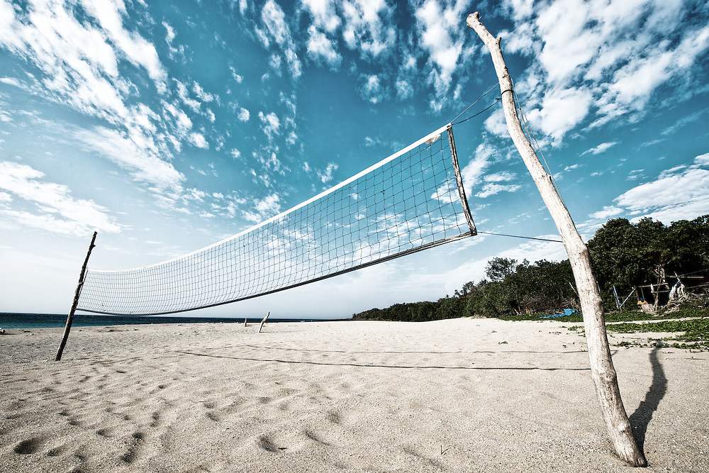 Beach volleyball net under clear sky