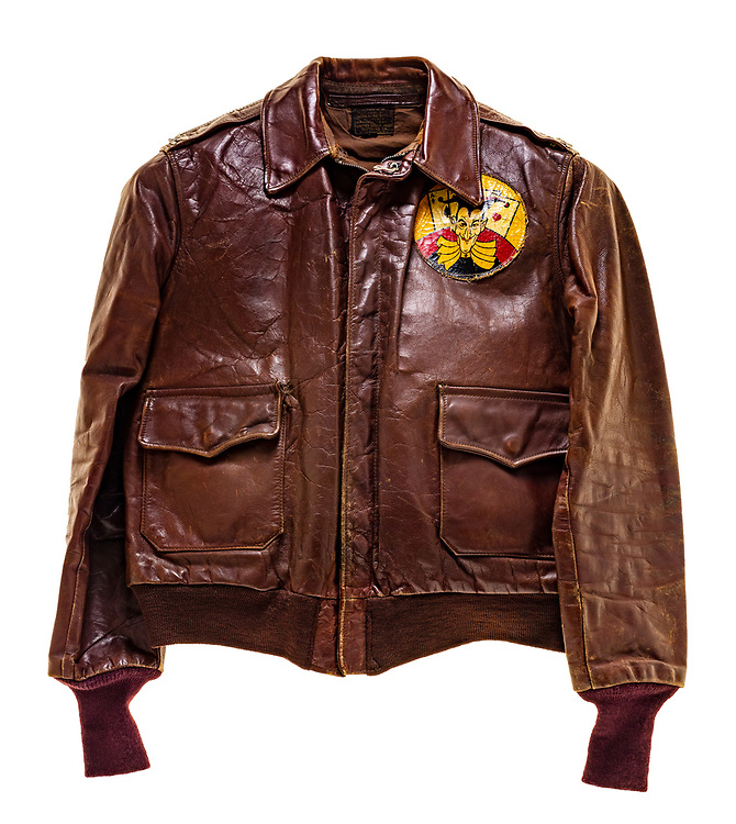 This type A-2 flight jacket was worn by a member of the 570th squadron, attached to the 390th Bomb Group. The 570th squadron insignia patch, a joker with 4 aces behind it, is attached to the front left of the jacket. There is no artwork on the back of the jacket, and no name plate on the front of it.  This jacket was owned by a full colonel.