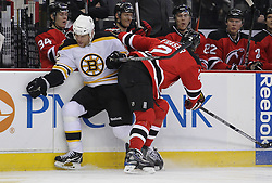 Apr 10; Newark, NJ, USA; New Jersey Devils defenseman Mark Fraser (2) hits Boston Bruins right wing Shawn Thornton (22) during the first period of their game at the Prudential Center.