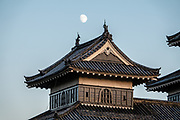 "The Moon rises over the keep of Matsumoto Castle, which was built 1592-1614 in Matsumoto, Nagano Prefecture, Japan. Matsumoto Castle is a ""hirajiro"" - a castle built on plains rather than on a hill or mountain, in Matsumoto. Matsumotojo's main castle keep and its smaller, second donjon were built from 1592 to 1614, well-fortified as peace was not yet fully achieved at the time. In 1635, when military threats had ceased, a third, barely defended turret and another for moon viewing were added to the castle. Interesting features of the castle include steep wooden stairs, openings to drop stones onto invaders, openings for archers, as well as an observation deck at the top, sixth floor of the main keep with views over the Matsumoto city."