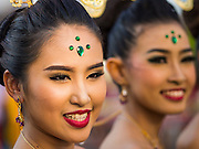 "14 JANUARY 2015 - BANGKOK, THAILAND:  Women in traditional attire march in the 2015 Discover Thainess parade. The Tourism Authority of Thailand (TAT) sponsored the opening ceremony of the ""2015 Discover Thainess"" Campaign with a 3.5-kilometre parade through central Bangkok. The parade featured cultural shows from several parts of Thailand. Part of the ""2015 Discover Thainess"" campaign is a showcase of Thailand's culture and natural heritage and is divided into five categories that match the major regions of Thailand – Central Region, North, Northeast, East and South.    PHOTO BY JACK KURTZ"