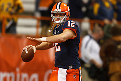 Oct 21, 2011; Syracuse NY, USA;  Syracuse Orange quarterback Ryan Nassib (12) warms up before the game against the West Virginia Mountaineers at the Carrier Dome.  Syracuse defeated West Virginia 49-23. Mandatory Credit: Jason O. Watson-US PRESSWIRE