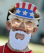 Nathan Brower, 11, of Levittown, Pennsylvania wears a patriotic Uncle Sam mask during the Tullytown Memorial Day Parade Saturday May 28, 2016 in Tullytown, Pennsylvania. Tullytown is celebrating it's  125th anniversary. (Photo by William Thomas Cain)