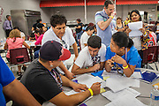 """25 AUGUST 2012 - PHOENIX, AZ:  Volunteers and immigration lawyers who volunteered their time help immigrants complete the paperwork necessary to apply for deferred action status at a workshop in Phoenix. Hundreds of people lined up at Central High School in Phoenix to complete their paperwork to apply for """"Deferred Action"""" status under the Deferred Action for Childhood Arrivals (DACA) program announced by President Obama in June. Volunteers and lawyers specialized in immigration law helped the immigrants complete the required paperwork. Under the program, the children of undocumented immigrants brought to the US before they turned 16 years old would not be subject to deportation if they meet a predetermined set of conditions.    PHOTO BY JACK KURTZ"""