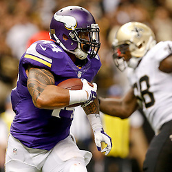 Sep 21, 2014; New Orleans, LA, USA; Minnesota Vikings running back Matt Asiata (44) runs against the New Orleans Saints during the second half of a game at Mercedes-Benz Superdome. The Saints defeated the Vikings 20-9. Mandatory Credit: Derick E. Hingle-USA TODAY Sports