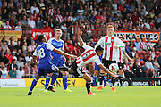 Ipswich midfielder Grant Ward (18) battling for ball with Brentford defender Nico Yennaris (8)  during the EFL Sky Bet Championship match between Brentford and Ipswich Town at Griffin Park, London, England on 13 August 2016. Photo by Matthew Redman.
