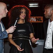 NLD/Amsterdam/20150203 - Uitreiking 100% NL Awards 2015, Jayh en Sharon Doorson reiken de award uit voor beste album van het jaar