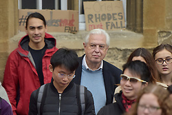 © Licensed to London News Pictures. 06/11/15 Oriel Square Oxford. UK. John Simpson - BBC. Protest for the removal of the statue of Cecil Rhodes which is in the front of Oriel College Oxford.. Photo credit : MARK HEMSWORTH/LNP