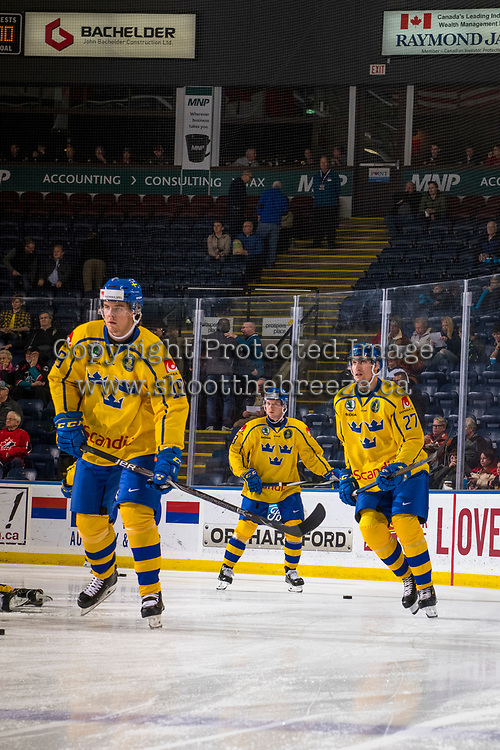 KELOWNA, BC - DECEMBER 18: David Gustafsson #27 and Filip Hållander #19 of Team Sweden warm up against the Team Russia at Prospera Place on December 18, 2018 in Kelowna, Canada. (Photo by Marissa Baecker/Getty Images)***Local Caption***