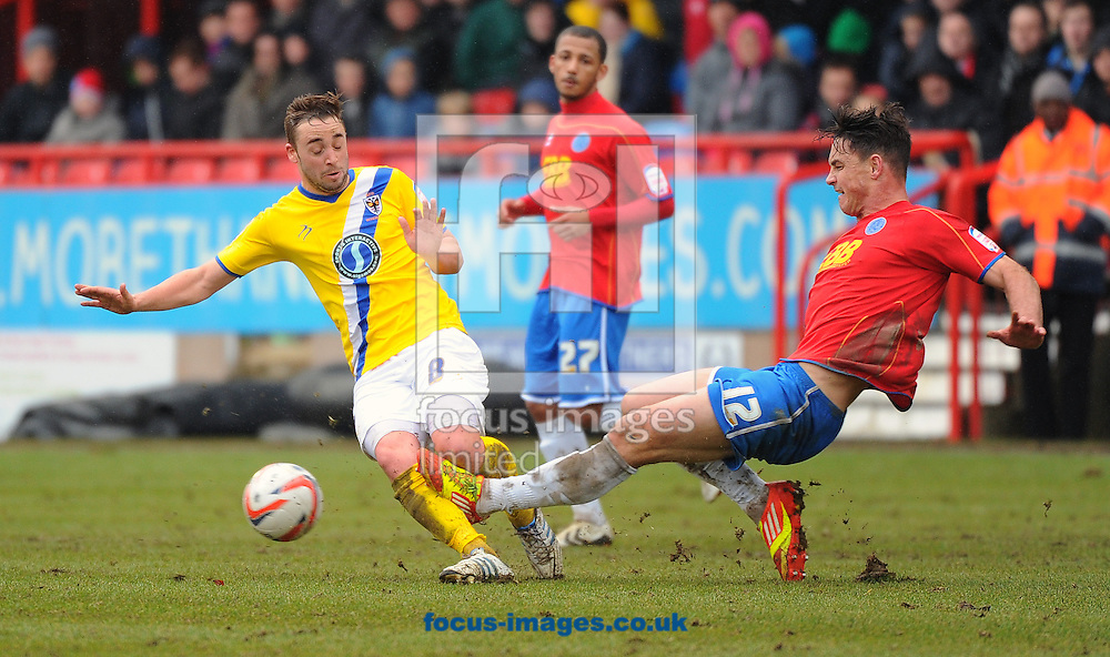 Picture by Seb Daly/Focus Images Ltd +447738 614630.16/03/2013.Oliver Risser of Aldershot Town and Sammy Moore of AFC Wimbledon during the npower League 2 match at the EBB Stadium, Aldershot.