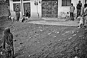 """Young mastiffs and kids in countryside of Rawalpindi. Pakistan, on wednesday, December 10 2008.....According to the Islamic tradition, angels do not enter a house which contains dogs. Even if they are considered """"ritually unclean"""" by the jurists, the fighting dogs of Pakistan are tolerated by institutions and by believers alike. These mastiffs are grown and trained explicitly for these matches. Spectators in this area flock-in from nearby villages whenever a famous dog is scheduled to enter the arena. And this is more than just a show: entire families base their social esteem on the results of such bloody confrontations."""