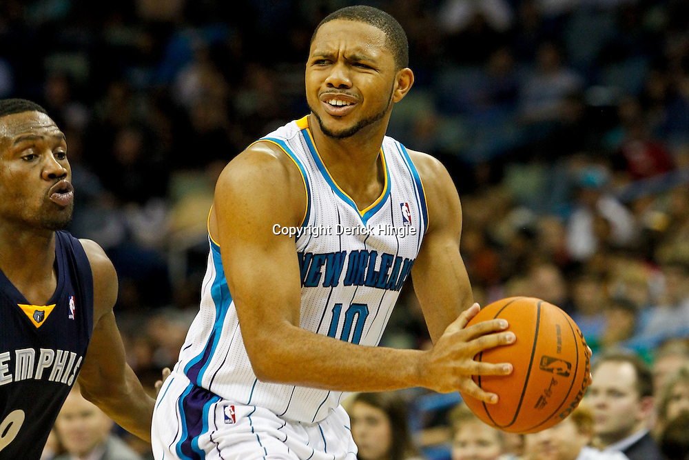 December 21, 2011; New Orleans, LA, USA; New Orleans Hornets shooting guard Eric Gordon (10) is defended by Memphis Grizzlies shooting guard Tony Allen (9) during the second quarter of a game at the New Orleans Arena.   Mandatory Credit: Derick E. Hingle-US PRESSWIRE