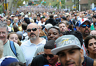 People stand in the line waiting to get through security for the Papal mass which stretched two blocks at noon near the Benjamin Franklin Parkway Saturday September 27, 2015 in Philadelphia, Pennsylvania.  (Photo By William Thomas Cain)