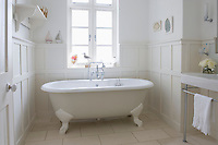 Freestanding roll top in panelled bathroom London