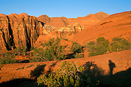 Sunrise light on red sandstone peaks in Snow Canyon State Park, Ivins, Utah's Dixie, near St. George, UTAH