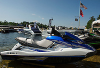 Jet Skis along the shore and boats at the docks with food and music in the Beach Bar await visitors during the Naswa Resort's Naz Aqua Mania this weekend.  (Karen Bobotas/for the Laconia Daily Sun)