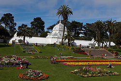 People sitting in the yard in front the Conservatory of Flowers, Golden Gate Park, San Francisco, California, United States of America