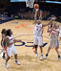 Virginia Cavaliers Center Siedah Williams (4)grabs a rebound against Miami.  The University of Virginia Cavaliers defeated the Miami Hurricanes Women's Basketball Team 73-60 at the John Paul Jones Arena in Charlottesville, VA on February 4, 2007.