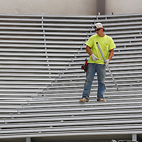 Thomas Wells | Buy at PHOTOS.DJOURNAL.COM<br /> A worker gets ready to install a section if pipe for the new bleachers in the North endzone at Vaught-Hemmingway Stadium Friday in Oxford.