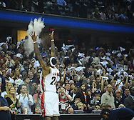 LeBron James of the Cleveland Cavaliers throws talcum powder in the air during his pre game ritual...The Cleveland Cavaliers defeated the Boston Celtics 108-84 in Game 3 of the Eastern Conference Semi-Finals at Quicken Loans Arena in Cleveland.