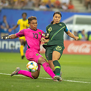 GRENOBLE, FRANCE June 18. Sam Kerr #20 of Australia scores her fourth goal of the game beating goalkeeper Nicole McClure #13 of Jamaica after her defensive error create thew chance during the Jamaica V Australia, Group C match at the FIFA Women's World Cup at Stade des Alpes on June 18th 2019 in Grenoble, France. (Photo by Tim Clayton/Corbis via Getty Images)