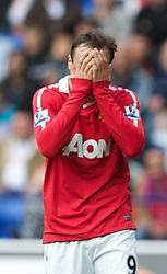 BOLTON, ENGLAND - Sunday, September 26, 2010: Manchester United's Dimitar Berbatov looks dejected as his side draw 2-2 with Bolton Wanderers during the Premiership match at the Reebok Stadium. (Photo by David Rawcliffe/Propaganda)