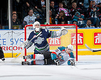 KELOWNA, CANADA - APRIL 3: Nick Merkley #10 of the Kelowna Rockets lies on the ice in front of Taran Kozun #35 of the Seattle Thunderbirds on April 3, 2014 during Game 1 of the second round of WHL Playoffs at Prospera Place in Kelowna, British Columbia, Canada.   (Photo by Marissa Baecker/Getty Images)  *** Local Caption *** Taran Kozun; Nick Merkley;