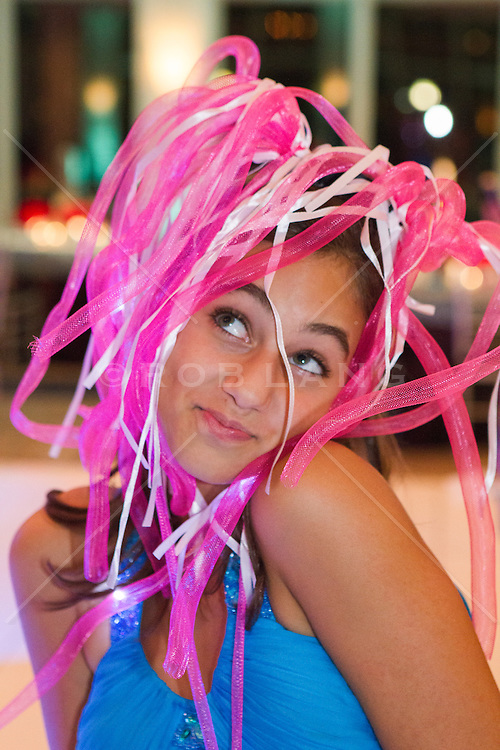 girl wearing a fun party hat