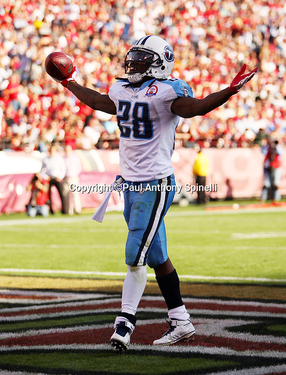 Tennessee Titans running back Chris Johnson (28) holds up the ball and his arms in celebration after running up the middle for a third quarter touchdown that ties the score at 17-17 during the NFL football game against the San Francisco 49ers, November 8, 2009 in San Francisco, California. The Titans won the game 34-27. (©Paul Anthony Spinelli)
