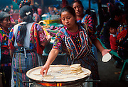 GUATEMALA, HIGHLANDS, MARKETS Chichicastenango; Sunday market, one of the world's most famous and colorful markets; women making tortillas