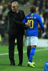 Brazil's Neymar leaves the field injured past manager Tite during the international friendly match at Stadium MK, Milton Keynes.
