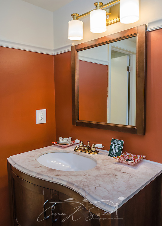 """An ornate sink is the focal point of a bathroom in one of the newly-remodeled guest rooms at University Inn, a family-owned hotel located near Emory University in Atlanta, Georgia, May 29, 2014. The inn opened in January 1971 and offers 60 rooms to meet the lodging needs of University parents and other Atlanta visitors. It was featured on the Travel Channel's """"Hotel Impossible,"""" May 26, 2014. (Photo by Carmen K. Sisson/Cloudybright)"""