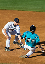 Virginia Cavaliers INF Tyler Cannon (10) tags out Coast Carolina Chanticleers OF Adam Rice (29) at second base.  The #24 ranked Virginia Cavaliers baseball team faced the Coastal Carolina Chanticleers at the University of Virginia's Davenport Field in Charlottesville, VA on April 15, 2008.