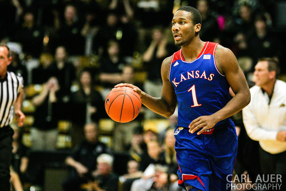 December 7th, 2013:  Kansas Jayhawks freshman guard Wayne Selden, Jr. (1) brings the ball up the quart in the first half of the NCAA Basketball game between the Kansas Jayhawks and the University of Colorado Buffaloes at the Coors Events Center in Boulder, Colorado