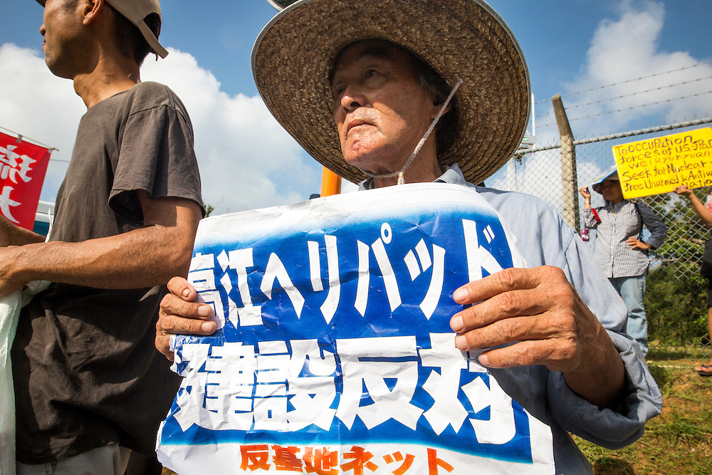 OKINAWA, JAPAN - AUGUST 19 : Anti U.S base protester holding a placard to protest against the construction of helipads in front of the main gate of U.S. military's Northern Training Area in the village of Higashi, Okinawa Prefecture, on August 19, 2016. Japanese government resume construction of total six helipads in a fragile ten million year old Yanbaru forest that is home to endemic endangered species such as the Okinawan rail and Okinawa wood pecker. (Photo by Richard Atrero de Guzman/NURPhoto)