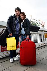 UK ENGLAND LONDON 15APR10 - Stranded airline passengers Daniel Maehlich (23, L) from Vienna and Nicole Ranseder (18, R) from lower Austria stand at Heathrow's Terminal 1 awaiting further news of air traffic. Today the UK's airspace was totally closed due to high altitude ash clouds after a volcanic eruption in Iceland...jre/Photo by Jiri Rezac..© Jiri Rezac 2010