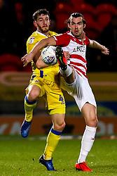 Tom Lockyer of Bristol Rovers challenges John Marquis of Doncaster Rovers - Mandatory by-line: Robbie Stephenson/JMP - 26/03/2019 - FOOTBALL - Keepmoat Stadium - Doncaster, England - Doncaster Rovers v Bristol Rovers - Sky Bet League One