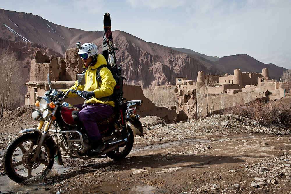 With his ski gear mounted on a rented motorcycle, John Trousdale passes by fortress-like qalat reminiscent of Bamiyan's ancient Silk Road glory.