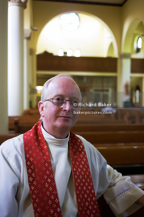 Ex-Anglican now Catholic priest Father Chris Viper at St. Lawrence's Catholic church in Feltham, London.