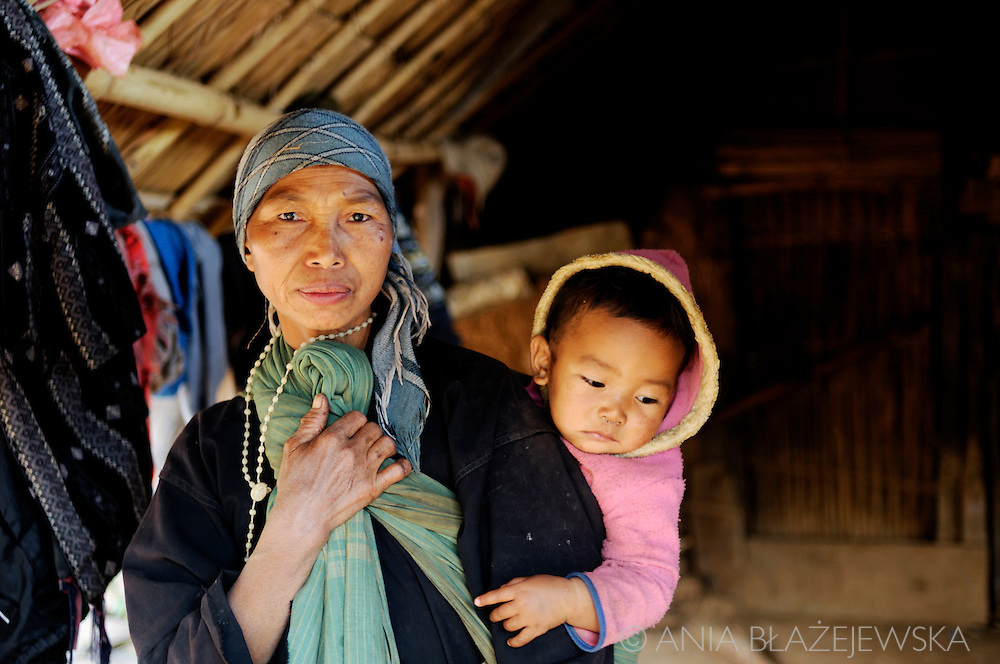 Burma/Myanmar. Akha woman with a baby.