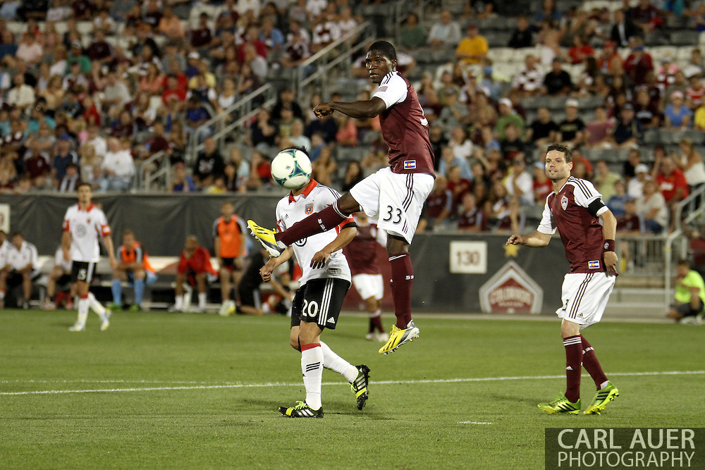 July 7th, 2013 - Colorado Rapids defender German Mera (33) elevates over D.C. United forward Carlos Ruiz (20) to clear the ball away from the goal in the second half of action in the Major League Soccer match between D.C. United and the Colorado Rapids at Dick's Sporting Goods Park in Commerce City, CO